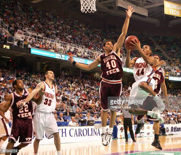 Sean Singletary 44# of the Virginia Cavliers drives against AD Vassallo of the Virginia Tech Hokies during day 1 of the Atlantic Coast Conference...