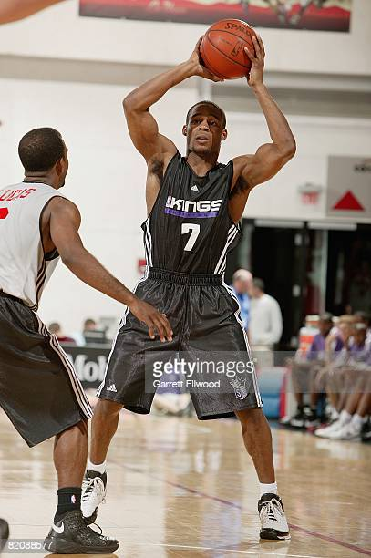 Sean Singletary of the Sacramento Kings looks to pass the ball over John Lucas of the Toronto Raptors during the NBA Summer League game presented by...