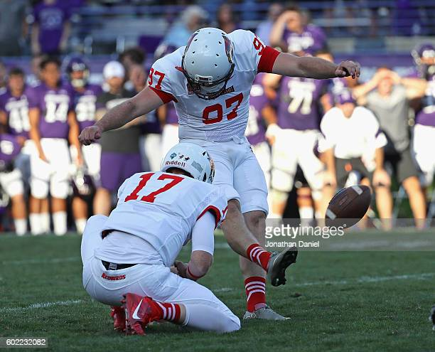 Sean Slattery of the Illinois State Redbirds kicks the gamewinning field goal out of the hold of Koty Thelen against the Northwestern Wildcats at...