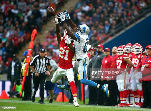 Sean Smith of the Kansas City Chiefs challenges for the ball with Calvin Johnson of the Detroit Lions during the NFL match between Kansas City Chiefs...