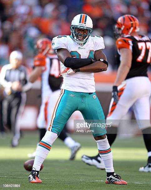 Sean Smith of the Miami Dolphins celebrates after intercepting a pass during the NFL game against the Cincinnati Bengals at Paul Brown Stadium on...