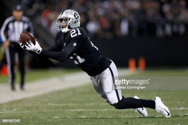 Sean Smith of the Oakland Raiders intercepts a pass by Dak Prescott of the Dallas Cowboys during their NFL game at OaklandAlameda County Coliseum on...