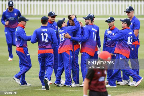 Sean Solia of Auckland is congratulated by team mates after dismissing Stephen Murdoch of Canterbury during the Ford Trophy match between Canterbury...