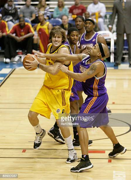 Sean Sonderleiter of the Fort Wayne Mad Ants battles Curtis Stinson of the Iowa Energy at Allen County Memorial Coliseum on December 5 2008 in Fort...