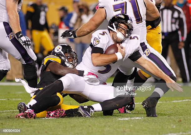 Sean Spence of the Pittsburgh Steelers sacks Joe Flacco of the Baltimore Ravens during the 2nd quarter of the game at Heinz Field on October 1 2015...