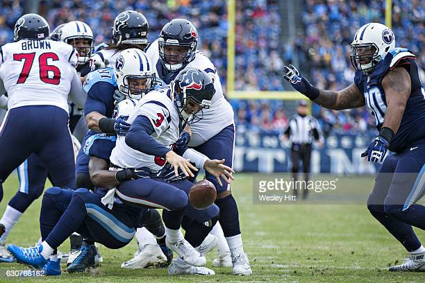 Sean Spence of the Tennessee Titans sacks and causes a fumble by Tom Savage of the Houston Texans at Nissan Stadium on January 1 2017 in Cleveland...
