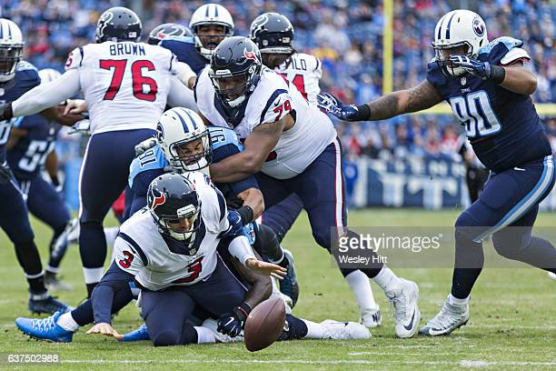 Sean Spence of the Tennessee Titans sacks and causes a fumble near the goal line by Tom Savage of the Houston Texans at Nissan Stadium on January 1...
