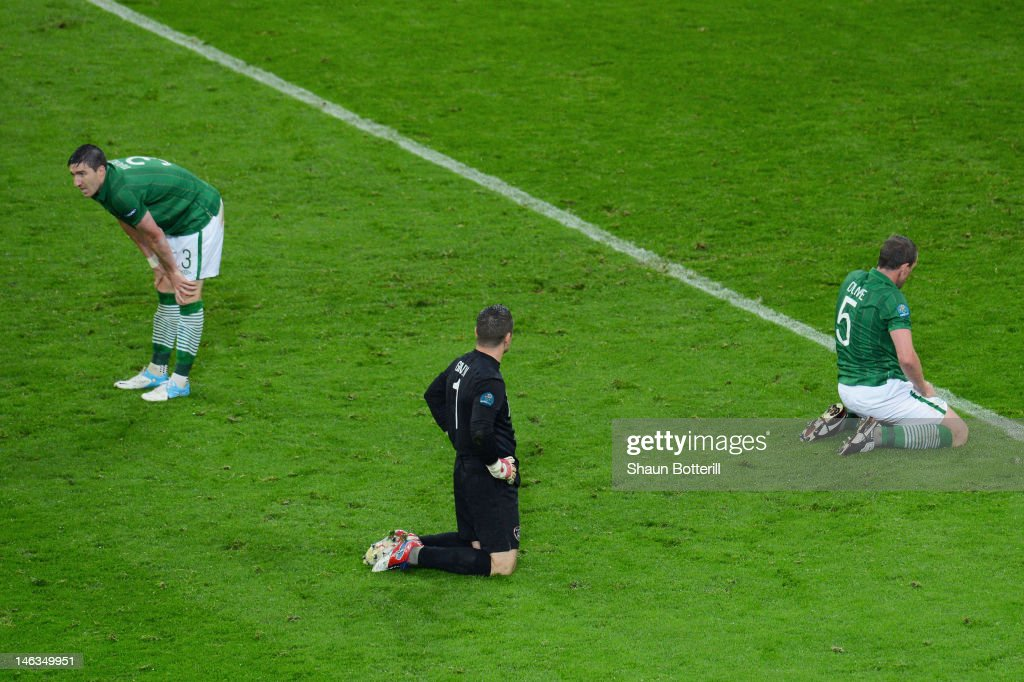 Sean St Ledger, Shay Given and Richard Dunne of Republic of Ireland sit dejected after Fernando Torres of Spain scored their third goal during the UEFA EURO 2012 group C match between Spain and Ireland at The Municipal Stadium on June 14, 2012 in Gdansk, Poland.