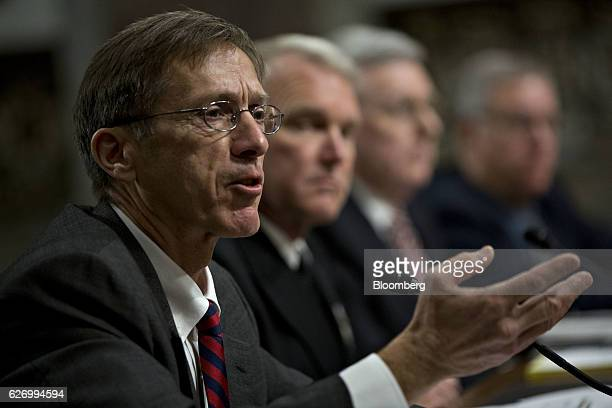 Sean Stackley assistant secretary for research development and acquisition at the Department of the Navy from left speaks as Vice Admiral Thomas...