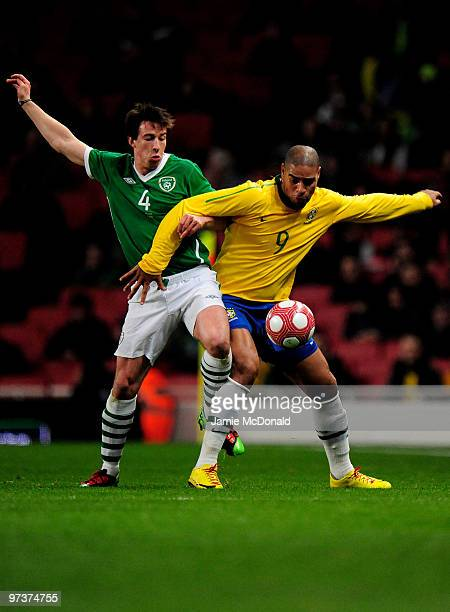 Sean StLedger of Ireland battles with Adriano of Brazil during the International Friendly match between Republic of Ireland and Brazil played at...