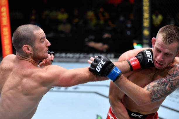 Sean Strickland punches Krzysztof Jotko of Poland in a middleweight bout during the UFC Fight Night event at UFC APEX on May 01, 2021 in Las Vegas,...