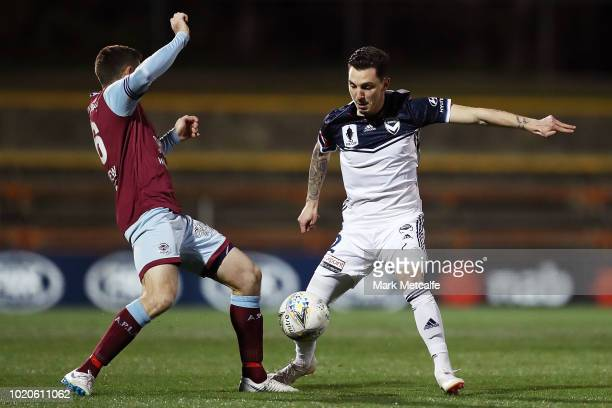 Sean Symons of APIA Leichhardt Tigers and Storm Roux of the victory compete for the ball during the FFA Cup round of 16 match between APIA Leichhardt...