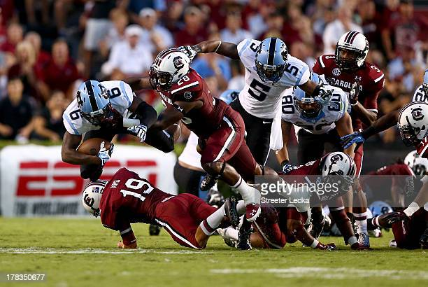 Sean Tapley of the North Carolina Tar Heels is tackled by Jonathan Walton of the South Carolina Gamecocks during their game at WilliamsBrice Stadium...