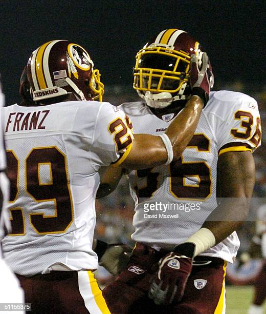 Sean Taylor of the Washington Redskins celebrates with teammate Todd Franz after intercepting a pass in the end zone from Denver Broncos quarterback...