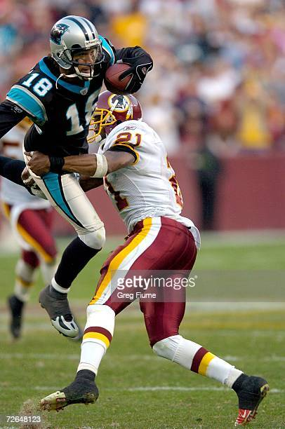 Sean Taylor of the Washington Redskins stops Drew Carter of the Carolina Panthers on fourth down on November 26 2006 at FedEx Field in Landover...