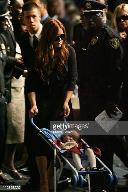 Sean Taylor's girlfriend Jackie Garcia and their young daughter Jackie arrive for the funeral services of Sean Taylor at the Pharmed Arena in the...