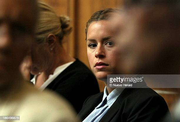 Sean Taylor's girlfriend, Jackie Garcia Haley, listens as Judge Dennis Murphy wraps up court for the day, after the jury finished a full day of...