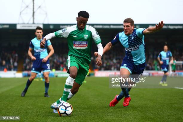 Sean Theobald of Letherhead is challenged by Adam ElAbd of Wycombe Wanderers during The Emirates FA Cup Second Round between Wycombe Wanderers and...