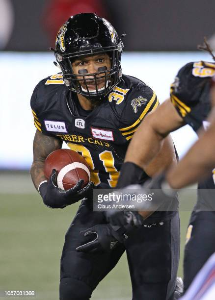 Sean Thomas Erlington of the Hamilton Tigercats runs the ball against the Montreal Alouettes in a CFL game at Tim Hortons Field on November 3 2018 in...