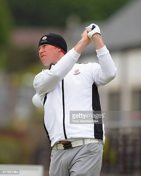 Sean Towndrow of Southport and Ainsdale plays his first shot on the 1st tee during The Amateur Championship 2015 Day Four at Carnoustie Golf Club on...