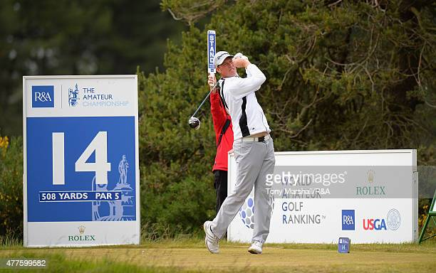 Sean Towndrow of Southport and Ainsdale plays shot his first on the 14th tee during The Amateur Championship 2015 Day Four at Carnoustie Golf Club on...