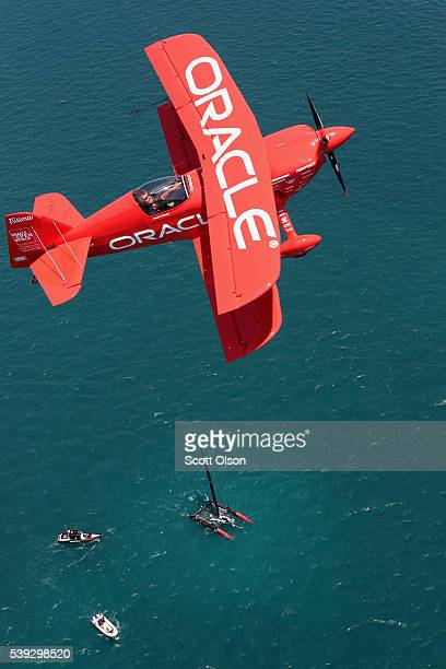 Sean Tucker flies his Team Oracle stunt plane over the Americas Cup race course as boats practice for this weekend's race on June 10 2016 in Chicago...