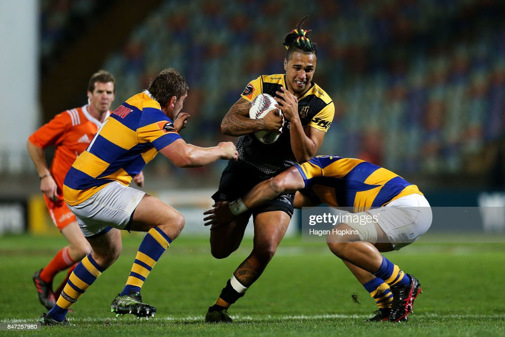 Sean Wainui of Taranaki is tackled by Aidan Ross and Henry Stowers of Bay of Plenty during the round five Mitre 10 Cup match between Taranaki and Bay of Plenty at Yarrow Stadium on September 15, 2017 in New Plymouth, New Zealand.