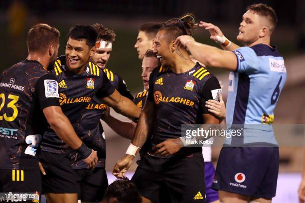 Sean Wainui of the Chiefs celebrates with his team mates after scoring a try during the round six Super Rugby match between the Waratahs and the...