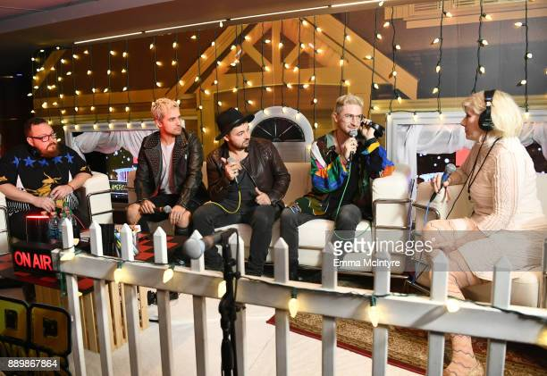 Sean Waugaman, Kevin Ray, Eli Maiman, and Nicholas Petricca of Walk the Moon speak to KROQ DJ Kat Corbett during an interview at KROQ Almost Acoustic...
