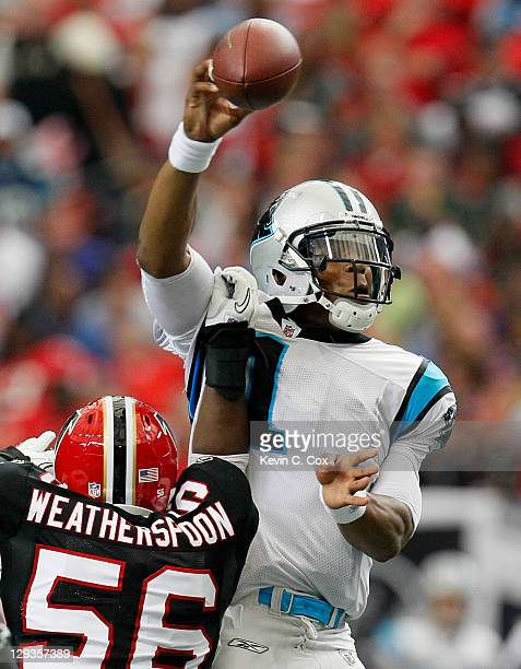 Sean Weatherspoon of the Atlanta Falcons forces a fumble by Cam Newton of the Carolina Panthers at Georgia Dome on October 16, 2011 in Atlanta,...