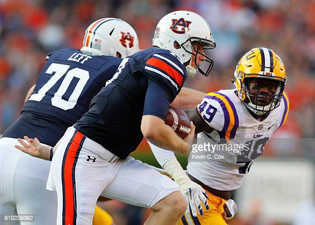 Sean White of the Auburn Tigers rushes against the Arden Key of the LSU Tigers at JordanHare Stadium on September 24 2016 in Auburn Alabama