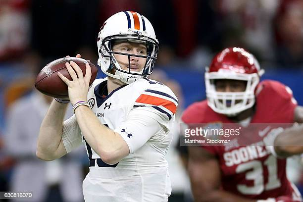 Sean White of the Auburn Tigers throws a pass against the Oklahoma Sooners during the Allstate Sugar Bowl at the MercedesBenz Superdome on January 2...