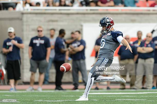 Sean Whyte of the Montreal Alouettes kicks the ball during the CFL game against the Hamilton TigerCats at Percival Molson Stadium on September 7 2014...