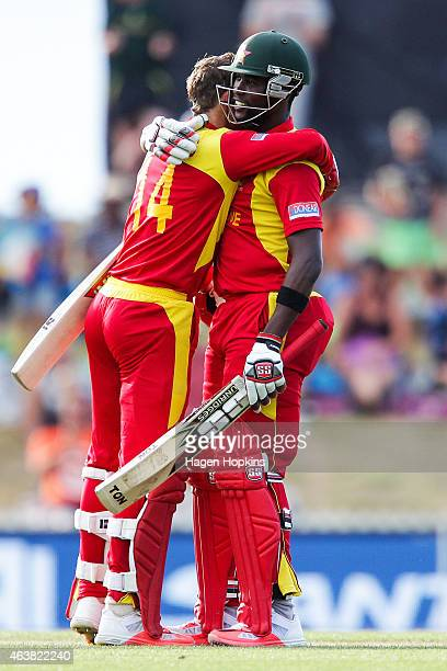 Sean Williams and Elton Chigumbura of Zimbabwe celebrate after winning the 2015 ICC Cricket World Cup match between Zimbabwe and the United Arab...