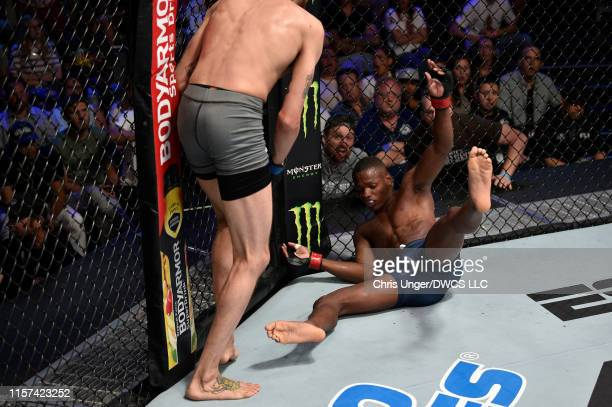 Sean Woodson knocks out Terrance McKinney with a knee in their featherweight bout during Dana White's Contender Series at the UFC Apex on July 23...