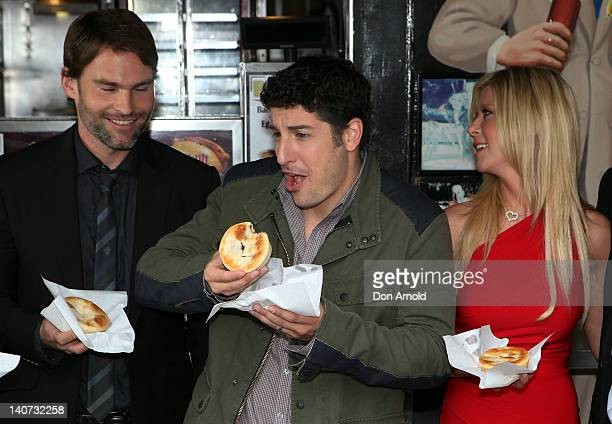 Seann William Scott Jason Biggs and Tara Reid sample pies during the American Pie Reunion photo call outside Harry's Cafe de Wheels on March 6 2012...