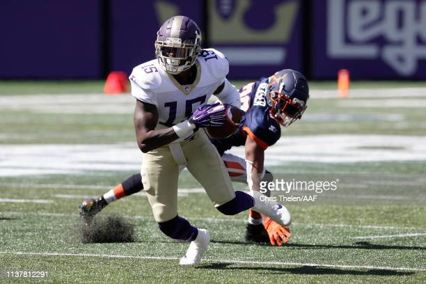 SeantaviusJones of the Atlanta Legends runs with the ball against KeithReaser of the Orlando Apollos during the second half in an Alliance of...