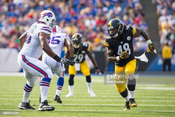 Seantrel Henderson of the Buffalo Bills tries to stop Bud Dupree of the Pittsburgh Steelers during a preseason game on August 29 2015 at Ralph Wilson...