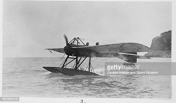 A seaplane designed by Deperdussin lands off the shore of Monaco during the 1913 Concours International d'Hydroaeroplanes