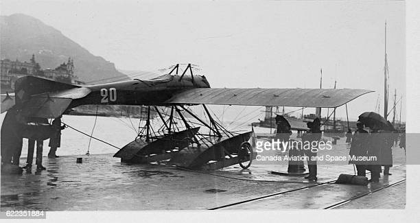 A seaplane designed by Deperdussin on a dock in Monaco during a test of reliability in bad weather for the 1913 Concours International...