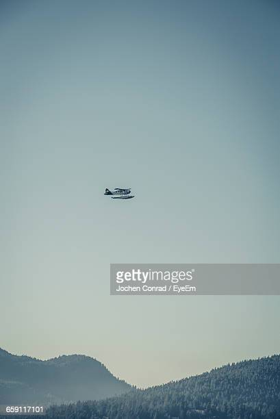 Seaplane Flying Over Mountain