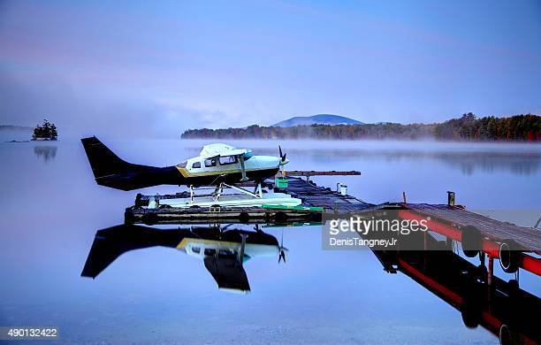 Seaplane on a calm lake in Maine