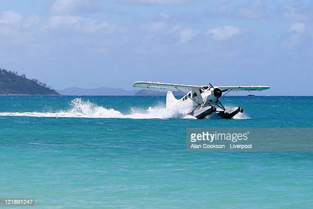 seaplane - whitehaven beach stock photos and pictures