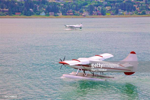 seaplanes landing and taking off in juneau, alaska - off stock pictures, royalty-free photos & images