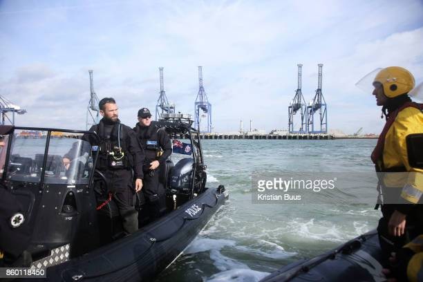 A Search and Marine police unit a at the scene in Sheerness harbour September 21st 2017 Thames Estuary Kent United Kingdom Greenpeace volunteers in...