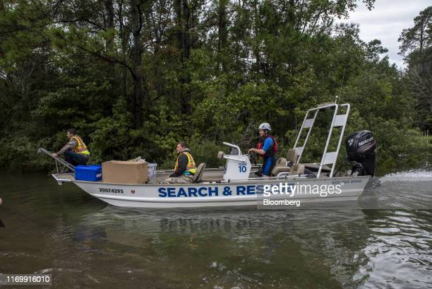 A search and rescue boat travels along a flooded highway following Tropical Storm Imelda in Fannett Texas US on Friday Sept 20 2019 The remnants of...