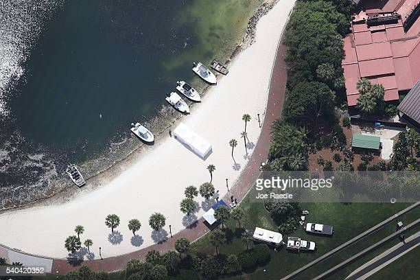 Search and rescue boats are seen on a beach near the Walt Disney World's Grand Floridian resort hotel where a 2yearold boy was taken by an alligator...