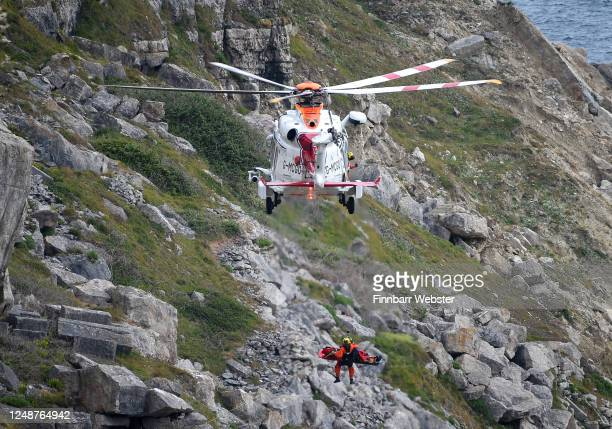 Search and Rescue Coastguard helicopter winches an injured person who authorities said is a climber from the cliffs at Weston on June 10 2020 in...