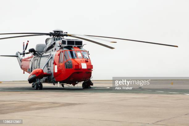 search and rescue helicopter on the ground - helicopter stock pictures, royalty-free photos & images
