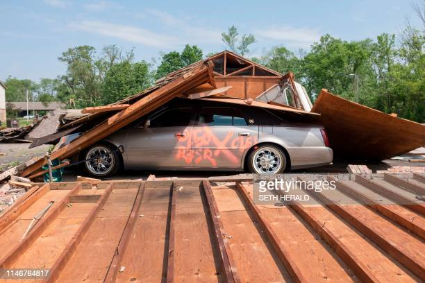 Search and rescue markings on a car indicate it has been searched in Trotwood Ohio on May 28 after powerful tornadoes ripped through the US state...